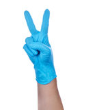 Hand of a medic wearing a blue latex gloves Stock Photo