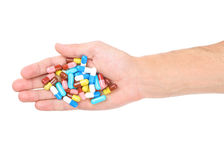 Hand with medical capsules Royalty Free Stock Photo