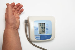 Hand and the medical device Stock Image