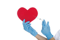 Hand with medical glove makes shot in the heart Royalty Free Stock Image