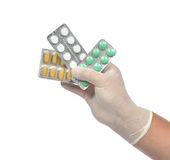 Hand medicine aspirin painkiller tablet pills Stock Image