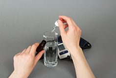 Hand with medicine for pressure and a tonometer Stock Photography
