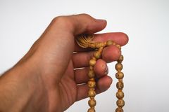 Hand meditation on Japa Mala Tulsi Beads stock image