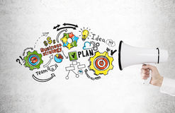 Hand with megaphone and business plan Stock Images