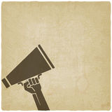 Hand with megaphone symbol old background Royalty Free Stock Images