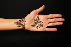 Hand with mehendi Stock Images