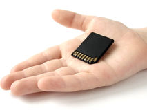 Hand with memory card 1. Child hand with a memory card Royalty Free Stock Photography