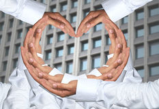 Hand of men concatenation a heart shape. Stock Image
