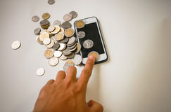 Hand men touch smart phone and money Stock Image