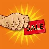 Hand met adreskaartjeverkoop en verkoop Royalty-vrije Stock Foto