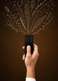 Hand met afstandsbediening en krullende lijnen Royalty-vrije Stock Foto