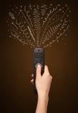 Hand met afstandsbediening en krullende lijnen Royalty-vrije Stock Afbeelding