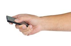 Hand met afstandsbediening op wit Stock Fotografie