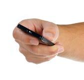 Hand met afstandsbediening op wit Royalty-vrije Stock Afbeelding