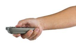 Hand met afstandsbediening op wit Stock Afbeeldingen
