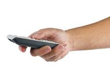 Hand met afstandsbediening op wit Stock Foto