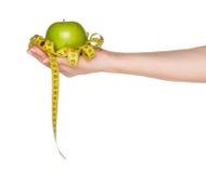 Hand met appel Royalty-vrije Stock Afbeeldingen