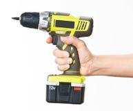 Hand met batterijschroevedraaier Royalty-vrije Stock Afbeeldingen
