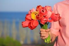 Hand met bloemen Royalty-vrije Stock Afbeelding