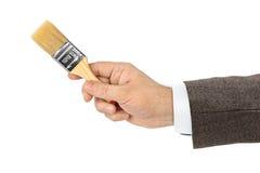 Hand met borstel royalty-vrije stock afbeelding