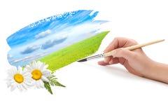 Hand met borstel en landschap royalty-vrije stock afbeeldingen