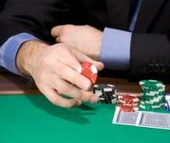 Hand met casinospaander Stock Afbeeldingen