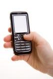 Hand met celtelefoon stock afbeeldingen
