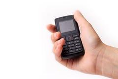 hand met celtelefoon Stock Foto's