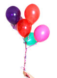 Hand met colorfullballons Stock Foto's
