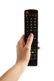Hand met de Afstandsbediening van TV stock afbeelding
