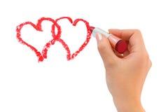 Hand met de harten van de lippenstifttekening Stock Foto's