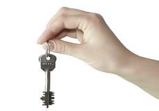 Hand met de sleutel stock afbeeldingen