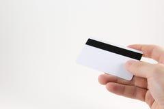 Hand met een creditcard op een witte achtergrond Stock Foto