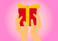 Hand met een gift Stock Fotografie