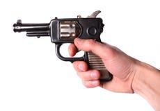 Hand met een oud speelgoed-kanon Stock Foto's