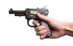 Hand met een oud speelgoed-kanon Royalty-vrije Stock Afbeelding