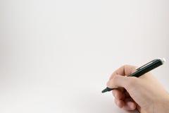 Hand met een pen op een witte achtergrond Royalty-vrije Stock Foto