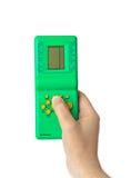Hand met elektronisch tetrisspel Stock Foto