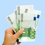 Hand met euro Stock Afbeeldingen