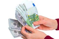 Hand met euro en dollar op wit Stock Afbeeldingen