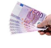 Hand met Euro geld stock foto