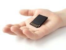 Hand met geheugenkaart Stock Fotografie