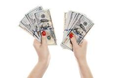 Hand met geld op een witte achtergrond wordt geïsoleerd die royalty-vrije stock afbeeldingen