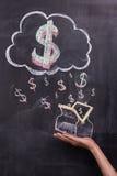 Hand met geschilderde dollartekens en beurs Stock Foto