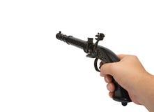 Hand met gestreefd oud kanon Stock Foto