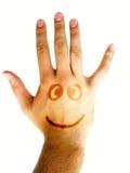 Hand met glimlach die op wit wordt geïsoleerdn Stock Foto's