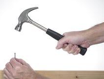 Hand met hamer Royalty-vrije Stock Foto