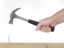 Hand met hamer Stock Afbeeldingen
