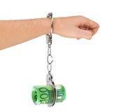 Hand met het breken van handcuffs en geld Royalty-vrije Stock Afbeeldingen