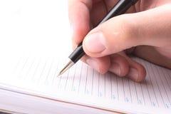 Hand met het handvat, dagelijks logboek, document Royalty-vrije Stock Fotografie